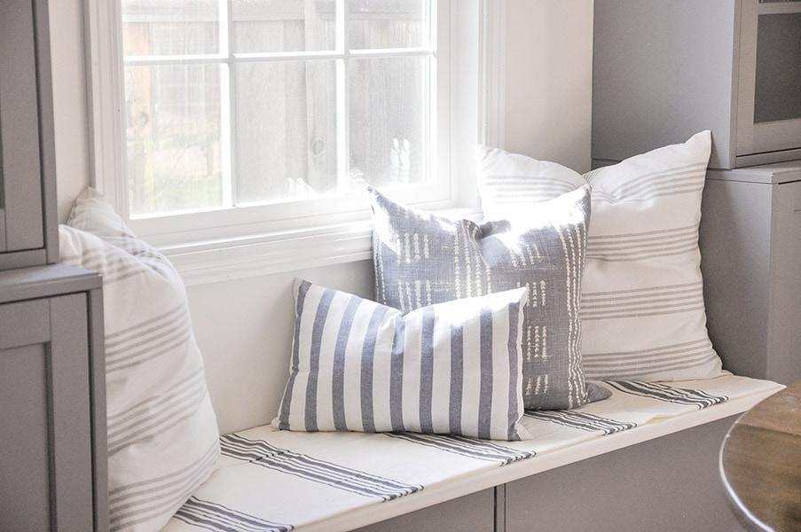 cost on DIY throw pillows, stripe fabric, on window seat, ikea dish towel, tablecloth, pottery barn napkin, world market