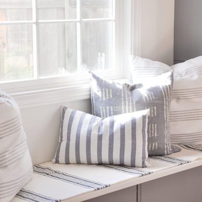 cost on DIY throw pillows, stripe fabric, on window seat, ikea dish towel, tablecloth, pottery barn napkin, world market