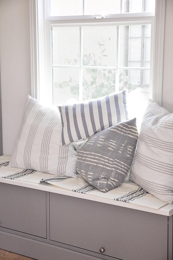 DIY decorative throw pillows in stripe fabric, on window seat, ikea dish towel, world market stripe tablecloth