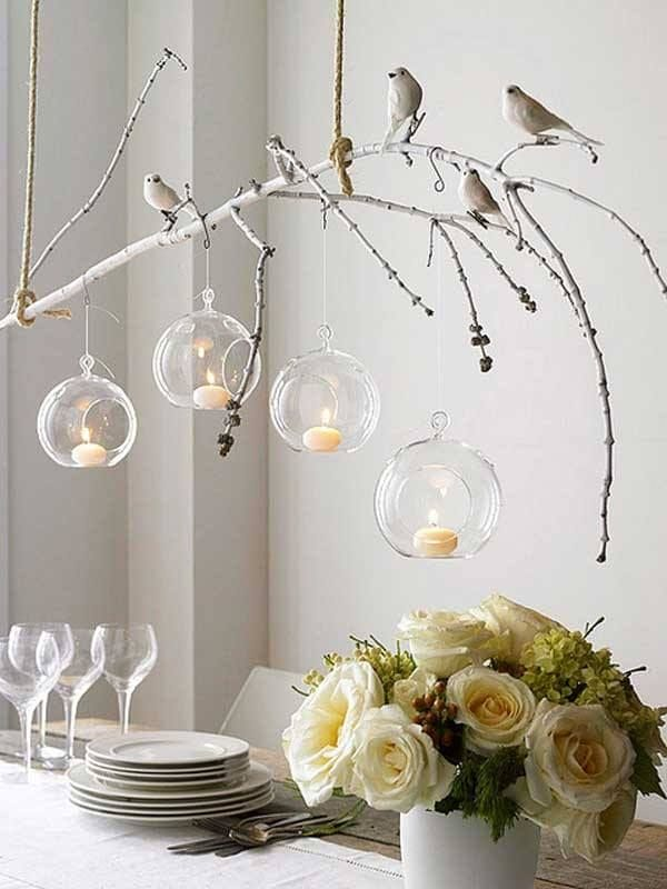 tree branch and bird hanging light fixture with glass globe and candles