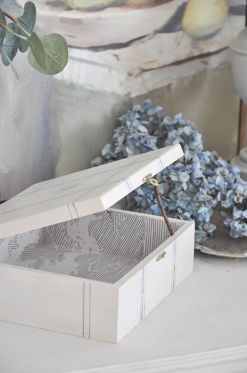 diy cigar box crafts project | anthropologie cloud formation wallpaper with blue dried hydrangea | console table vignette