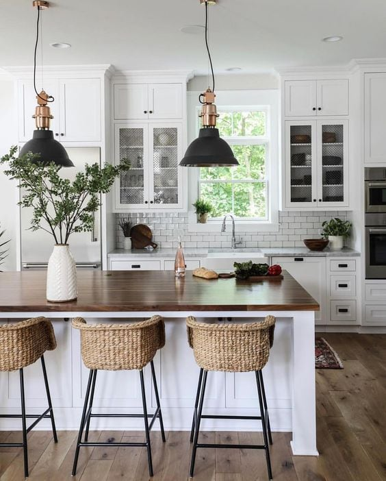 modern farmhouse | black pendant light over kitchen island, white kitchen cabinet with dark wood countertop