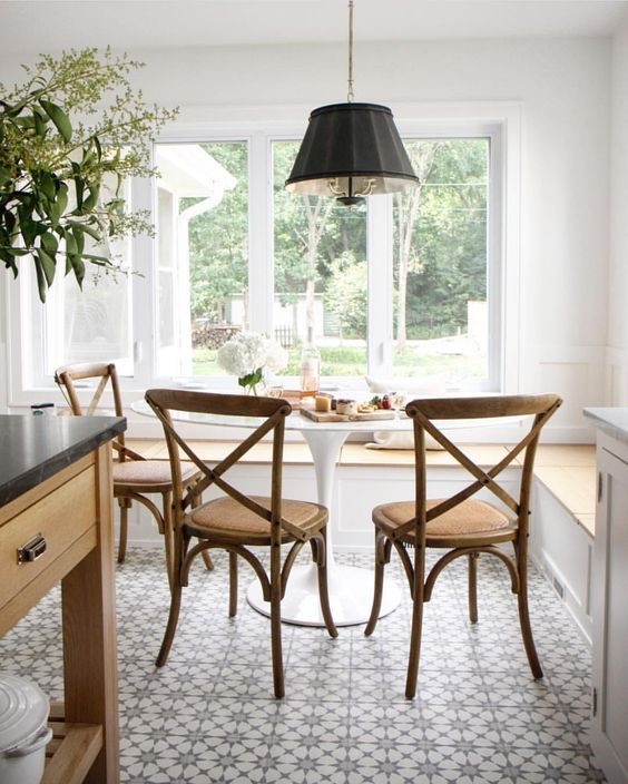 my favorite interior design style series | modern farmhouse | beautiful modern farmhouse spaces | black drum shade pendant, dining room with farmhouse chair, dining room with patterned tiles