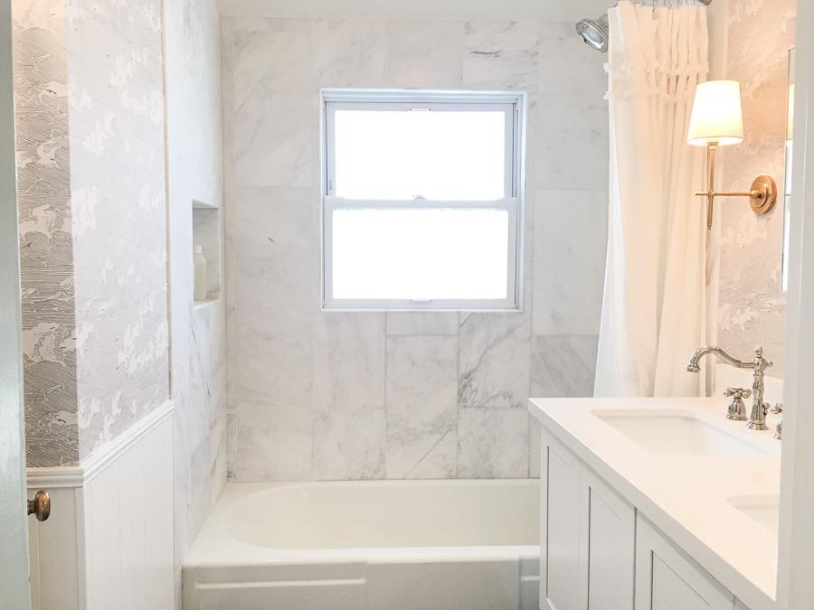 master bathroom remodel, small bathroom renovation, diy install wallpaper, 12 by 24 venato carrara marble subway tile in shower bath combo