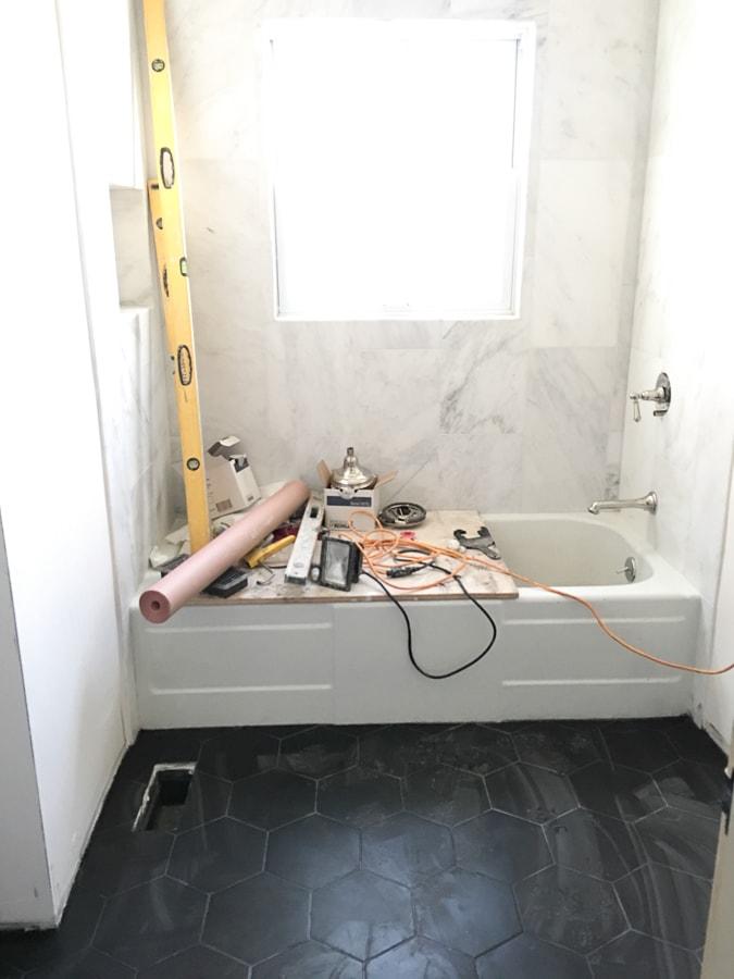 bathroom renovation black hex tile