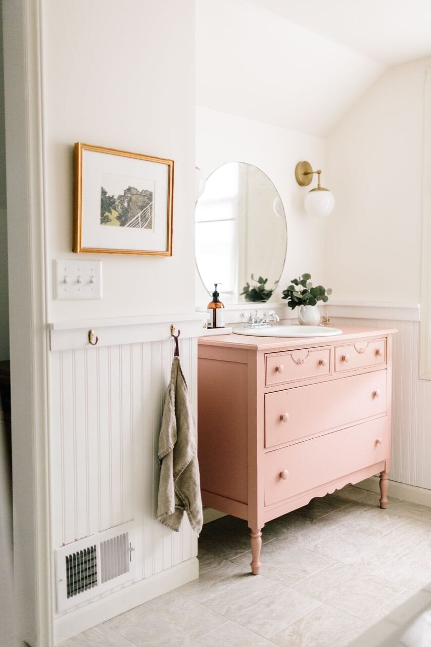 pink repurposed dresser as bathroom vanity, beadboard white wainscoting, cute small bathroom, pink | my favorite interior design style series | modern farmhouse | beautiful modern farmhouse spaces | traditional, rustic, clean, airy, fresh