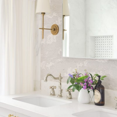 small master bathroom interior design, visual comfort bryant sconces, anthropologie cloud formation wallpaper, white double vanity, black hex tile