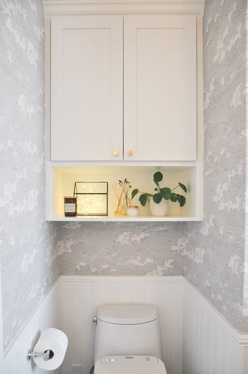 small bathroom remodel, master bath, above toilet vanity wall cabinet with shelf, hygge string light, pilea plant