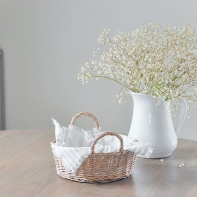 diy napkin holder, napkin box, vintage basket, thrifted, dried baby's breath bouquet in white pitcher