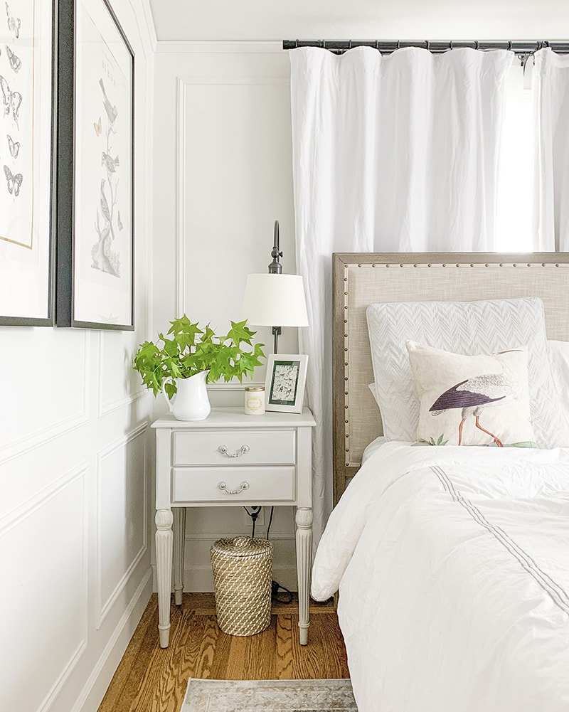 serene and neutral bedroom design, with pottery barn toulouse bed and wall sconces with shades