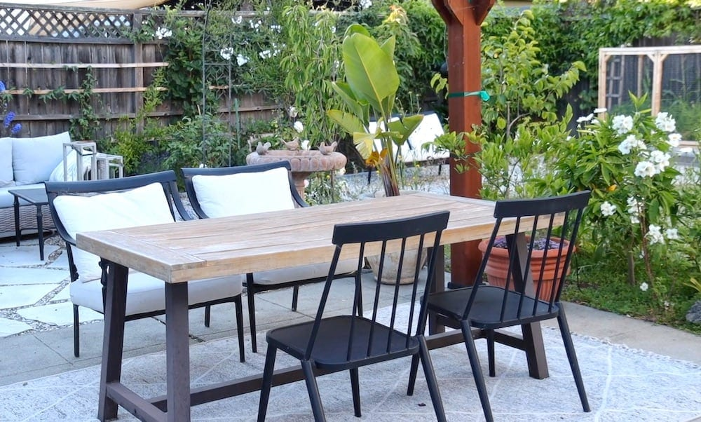 outdoor dining space with world market outdoor dining table