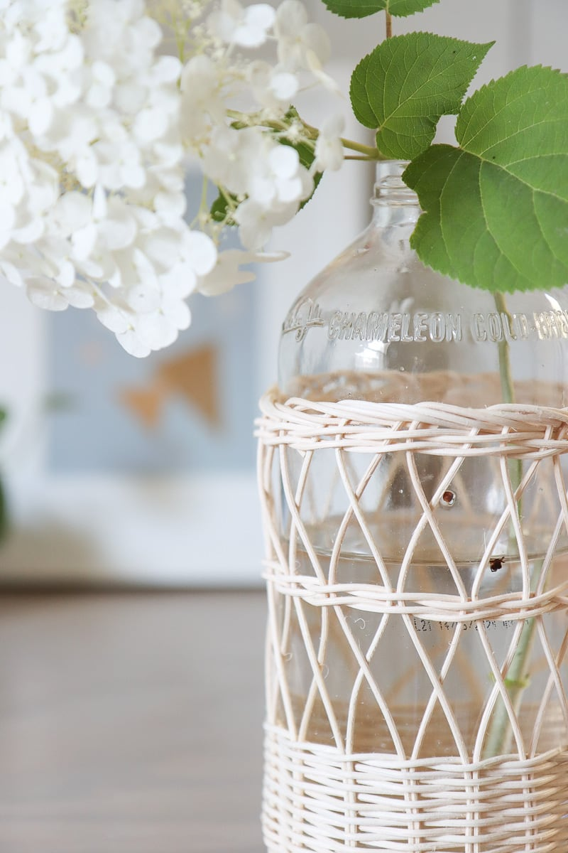 wicker covered glass bottles