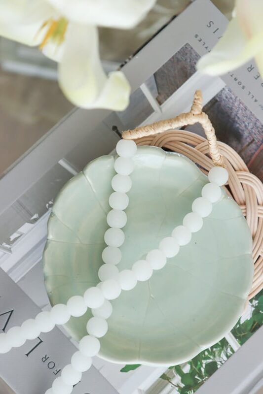 mint green dish with white beads decor